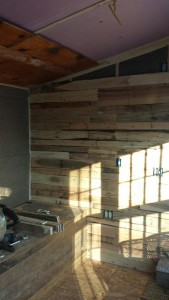 Pallet boards look great as siding once they're cleaned up!
